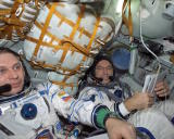 ISS-04_Yury_Onufriyenko_and_Carl_E._Walz_in_the_Soyuz_TM-33_spacecraft